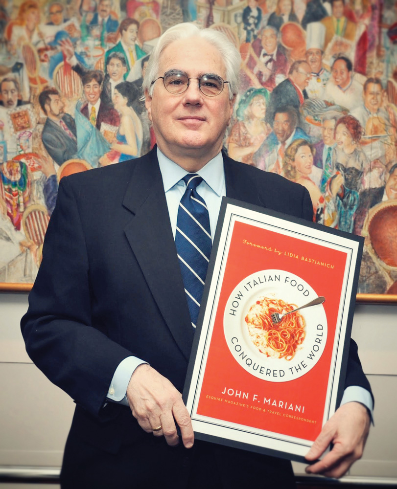 Esquire columnist and acclaimed food writer John Mariani with the cover of his most recent book, How Italian Food Conquered the World Photo Courtesy of John Mariani
