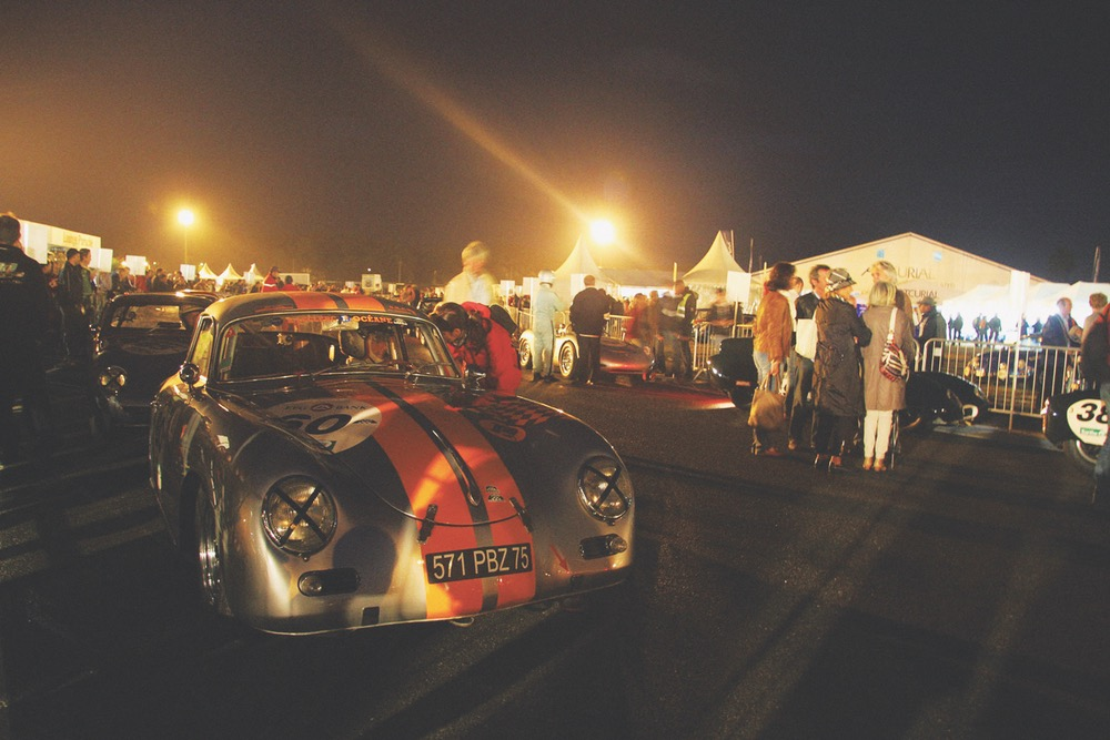 A classic Porsche 356A in the foreground of this photo by Claude Maudoux taken during the early morning hours of pre-race camaraderie. Every two years since 2002, the Le Mans Classic has been the go-to event for historic race car enthusiasts the world over. The July 7, 2012 event hosted almost 450 racers with about 8,000 specimens of vintage classics on display.