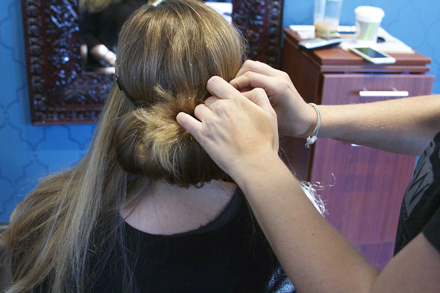 Step Two: Fold over loose strands of hair from underneath the headband. Tuck it in the headband as loos or tight as you would like it. Don't worry about it being too messy. You can make this hairstyle as neat or messy as you choose.