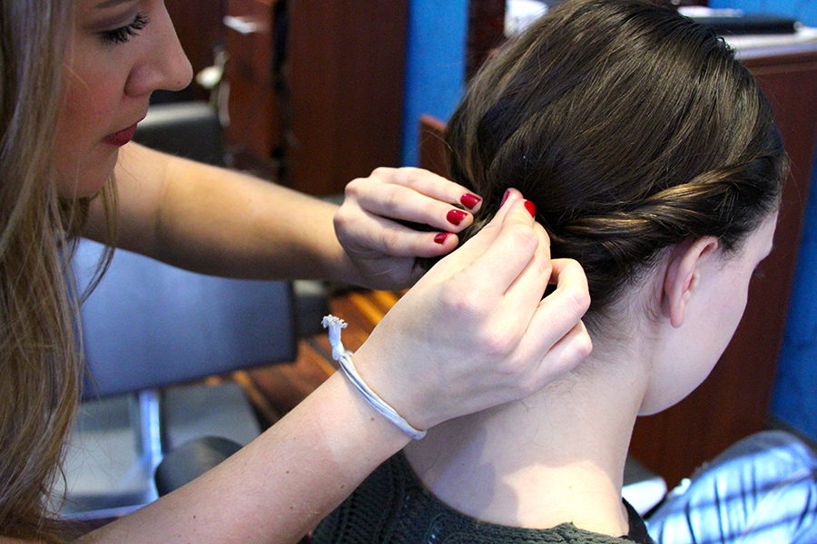 Step Four: Use bobby pins and start to form your messy bun and secure placement.