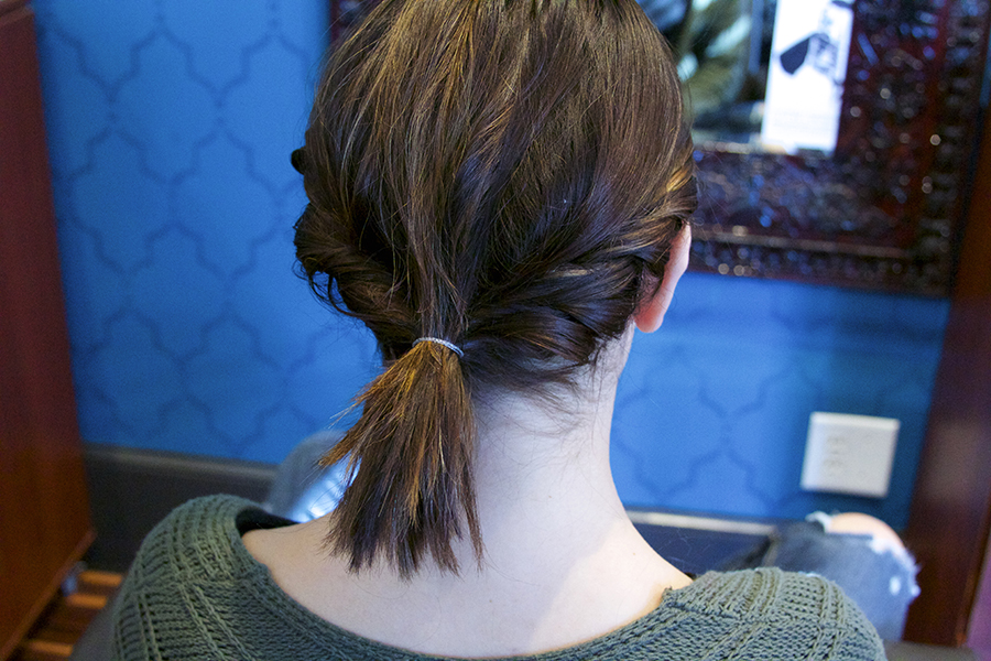 Step Three: After you've twisted both sides, join them together in a ponytail. If you have longer hair, then grab another hair tie and loop your hair to start to form your messy bun.