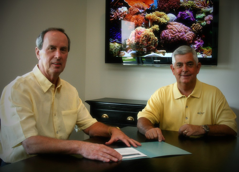 Joe Taylor (Sales Manager) & Tim Taylor (Broker President) vie magazine ocean reef