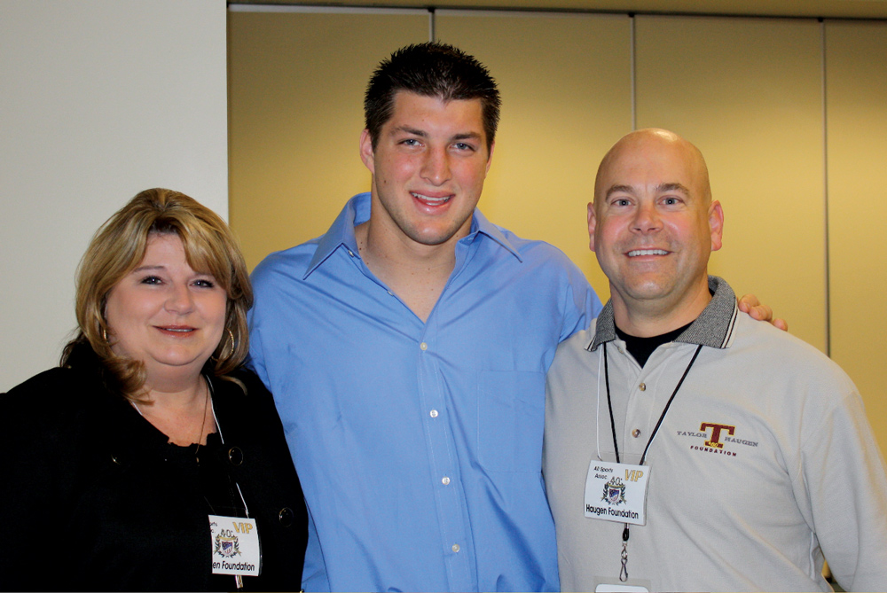 Kathy Haugen, Tim Tebow, Brian Haugen Photo by Philippe Miceli