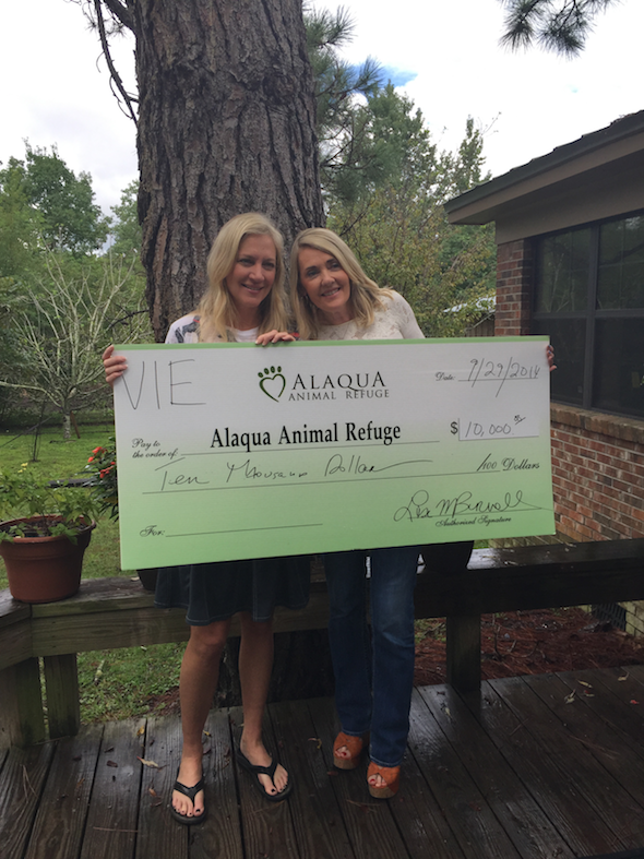 Alaqua's Laurie Hood and VIE's Lisa Burwell at the refuge