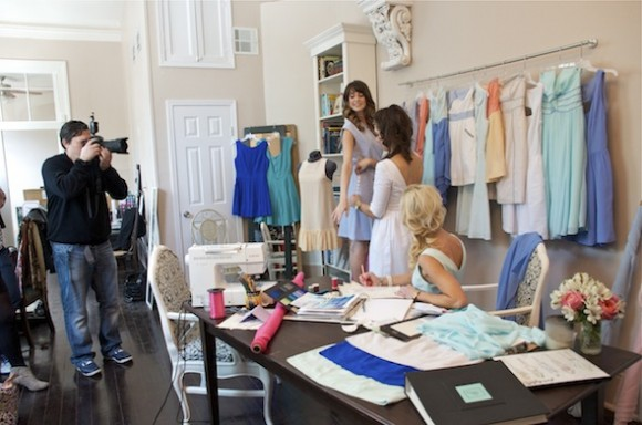 Designers Sarah Elizabeth and Jolie fit one of their models for the photo shoot with VIE.