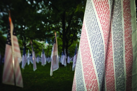 Flags scripted with the fallen's names filled Battery Park in memory.