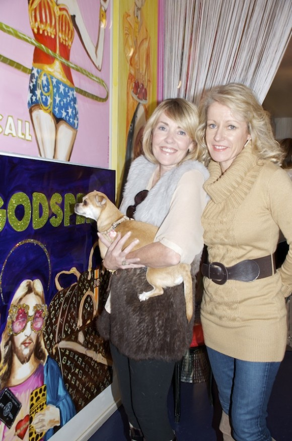 Publisher Lisa Burwell, ad exec Mary Jane Kirby, and VIE office manager Sucre browse Ashley Longshore's art.
