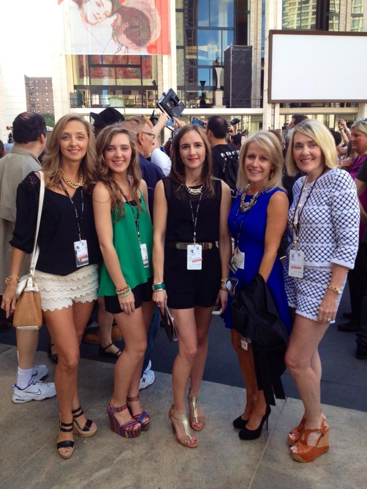 Renee Ryan, Abigail Ryan, Tracey Thomas, Mary Jane Kirby, and Lisa Burwell pose outside New York Mercedes-Benz Fashion Week at Lincoln Center.