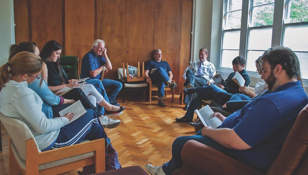The UWF Group Gathered Around Enjoying Each Other's Company