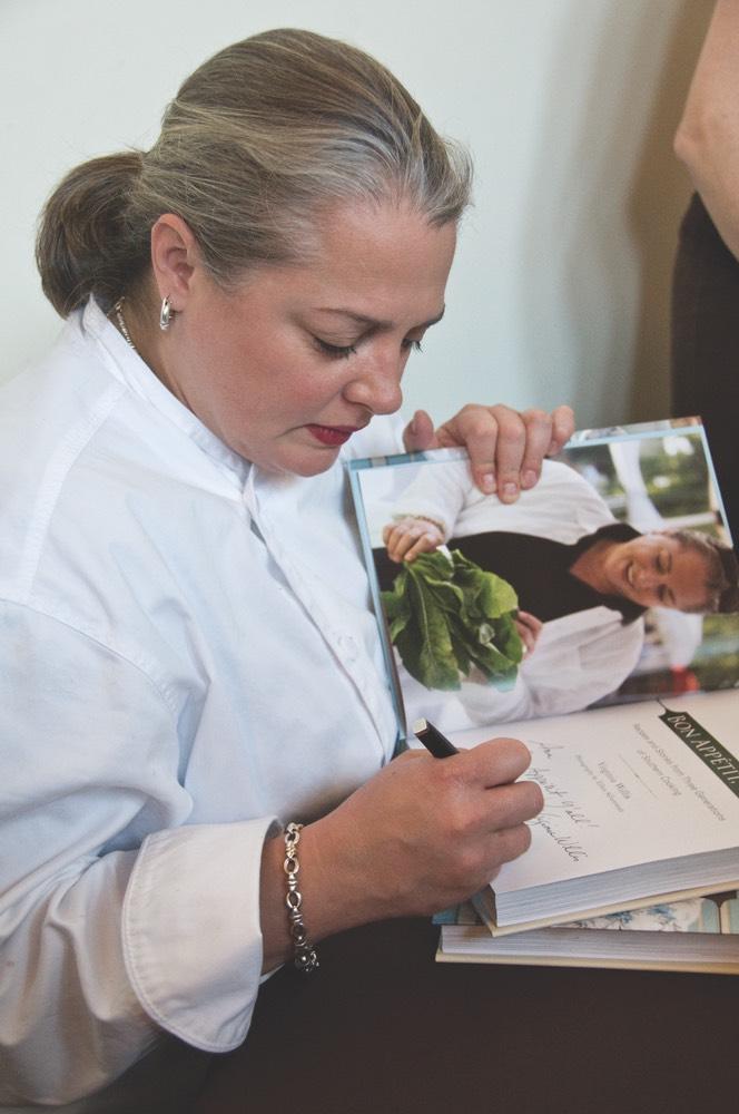 Virginia Willis signing copies of Bon Appétit, Ya'll vie magazine cookbook