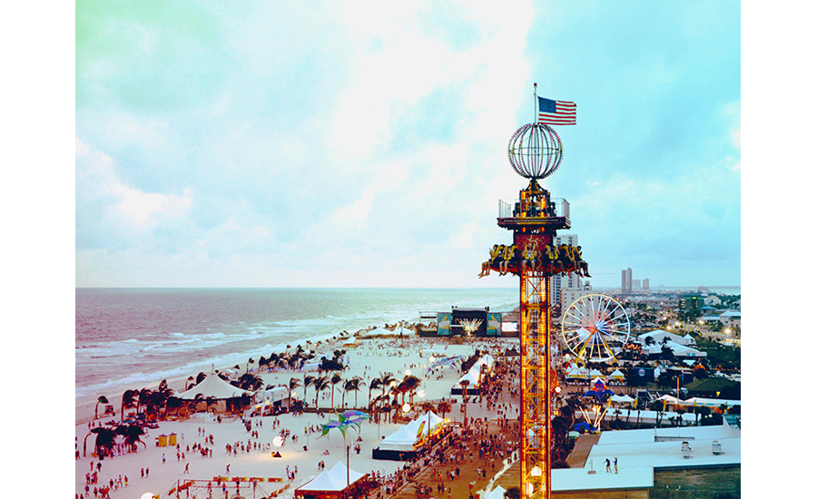 A Profile View Of Carnival Rides and Tents At The Hangout Music Festival And Gulf Shore Beach
