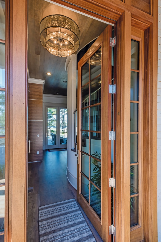 Doorway with chandelier Savoie Architects Sugar Beach Interiors