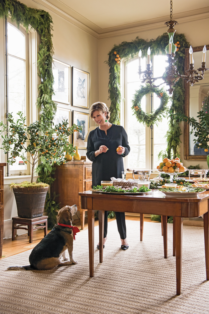 Julia Reed in her home with her dog at Christmas