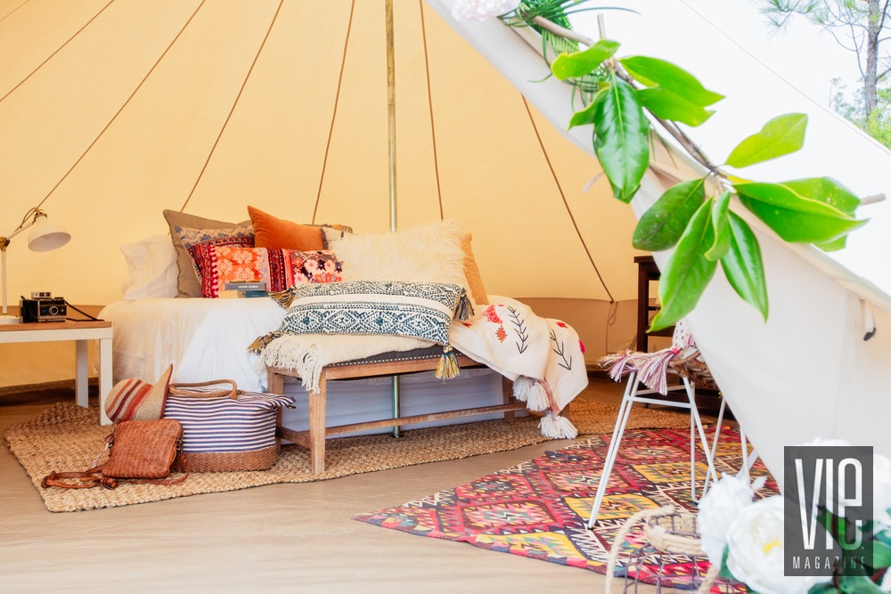 Interior shot of a Fancy Camps tent luxurious camping glamping outdoors pillows