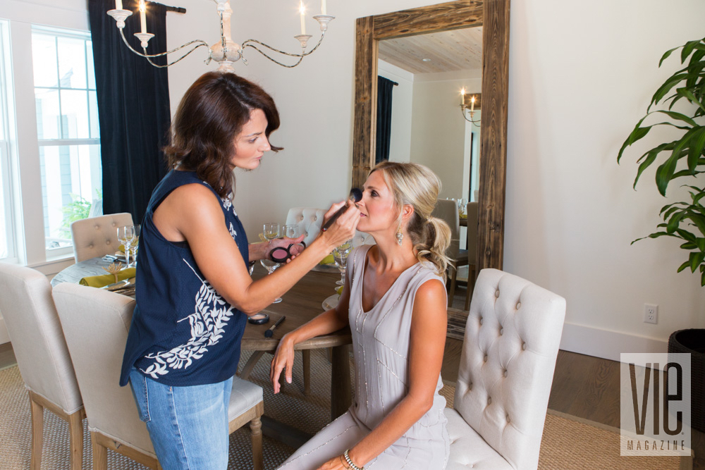 Makeup artist doing final touch ups