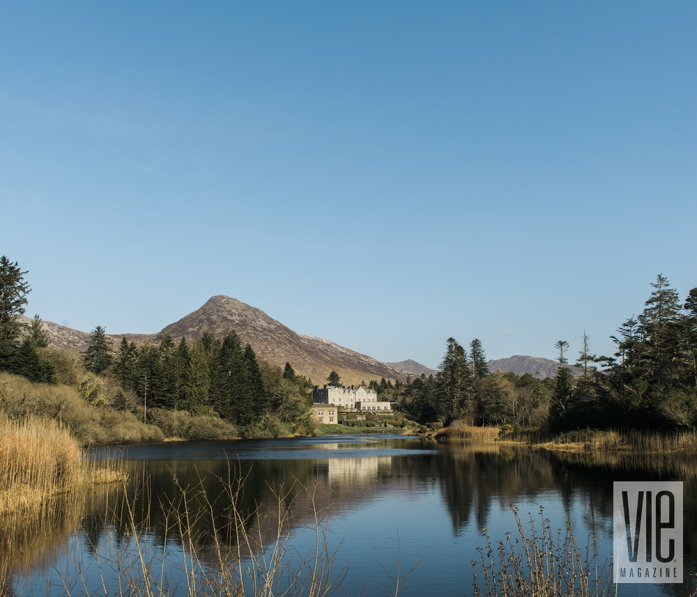 Landscape shot of Ballynahinch Castle in Ireland blue skies reflection The Sophisticate Issue 2016
