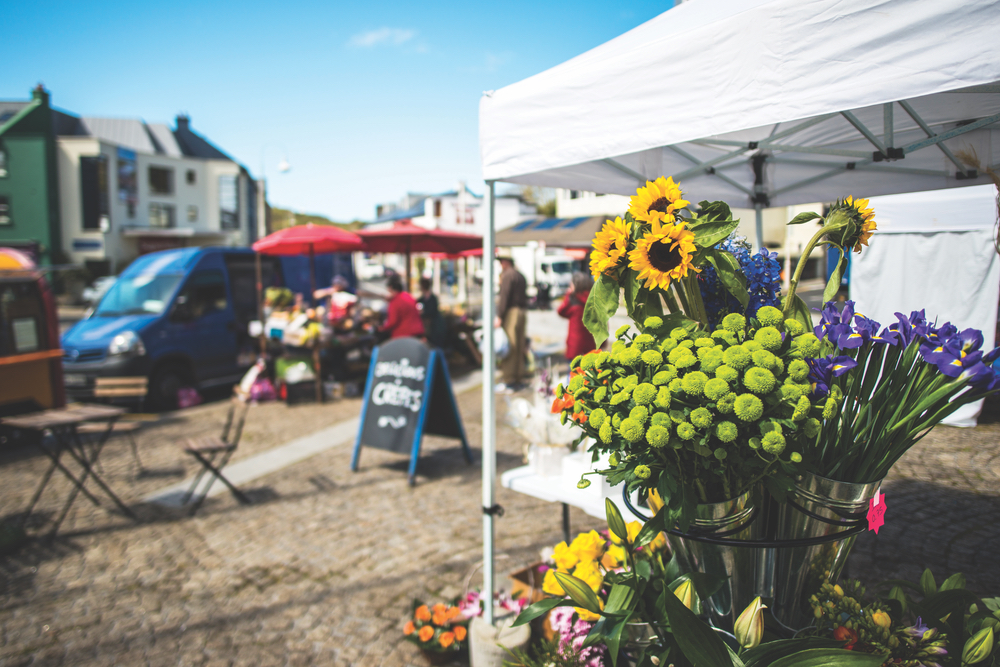Take a stroll through the town's vibrant market each Friday to pick up fresh flowers and other local goods. You may even hear some music on the street!