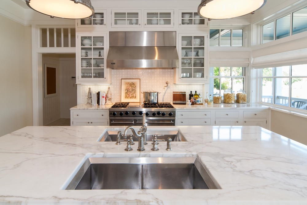Beautiful clean white kitchen with gorgeous countertops Erin Oden The Sophisticate Issue 2016