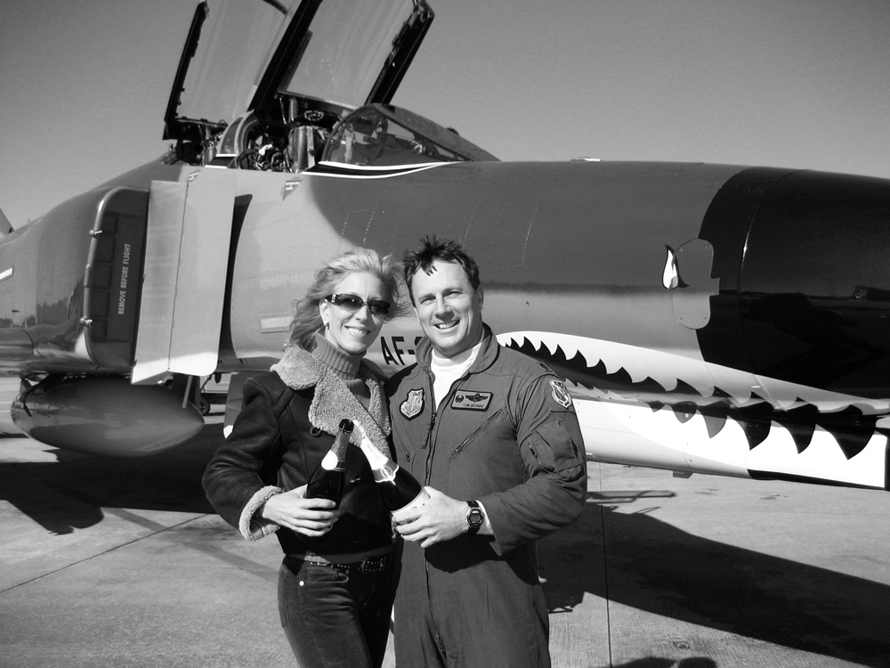 Squadron Commander Lieutenant Colonel Thomas Behnke celebrates his final Air Force flight with his wife, Melissa.