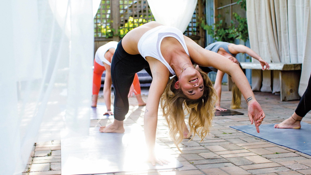 Women doing yoga outside in Lululemon gear. Photo courtesy of Lululemon.