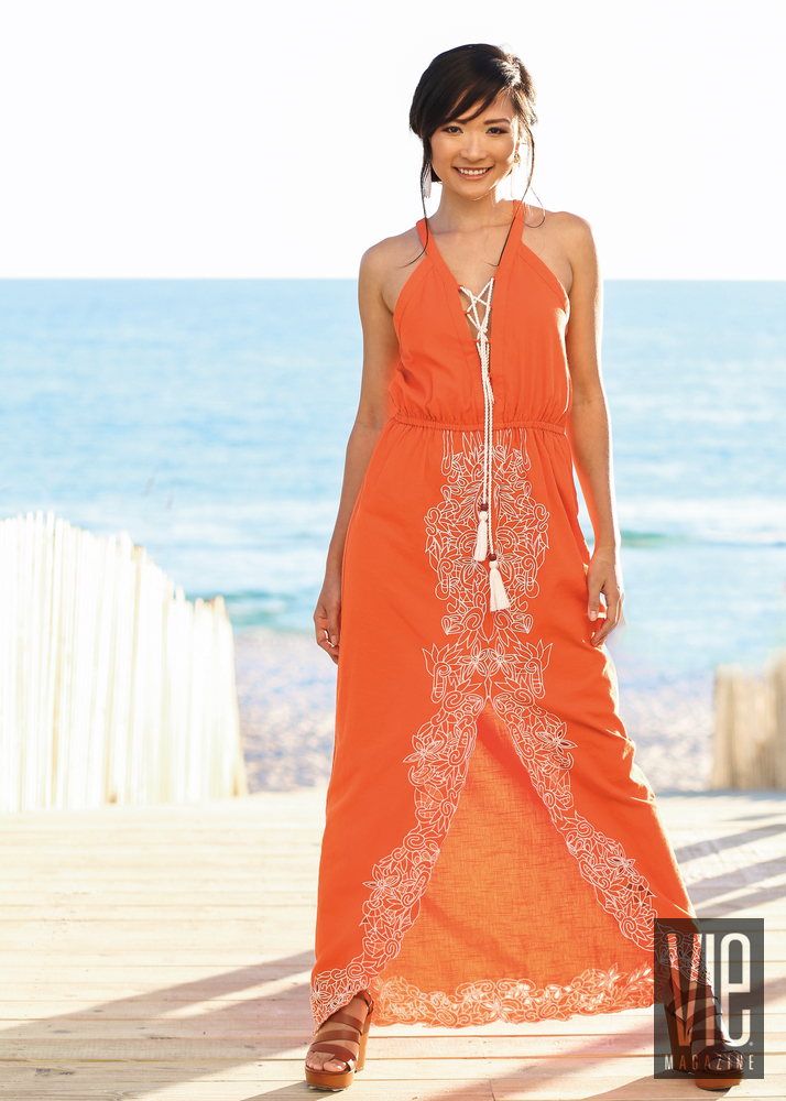 Beautiful model in an orange dress at the beach hair tutorial chic updo