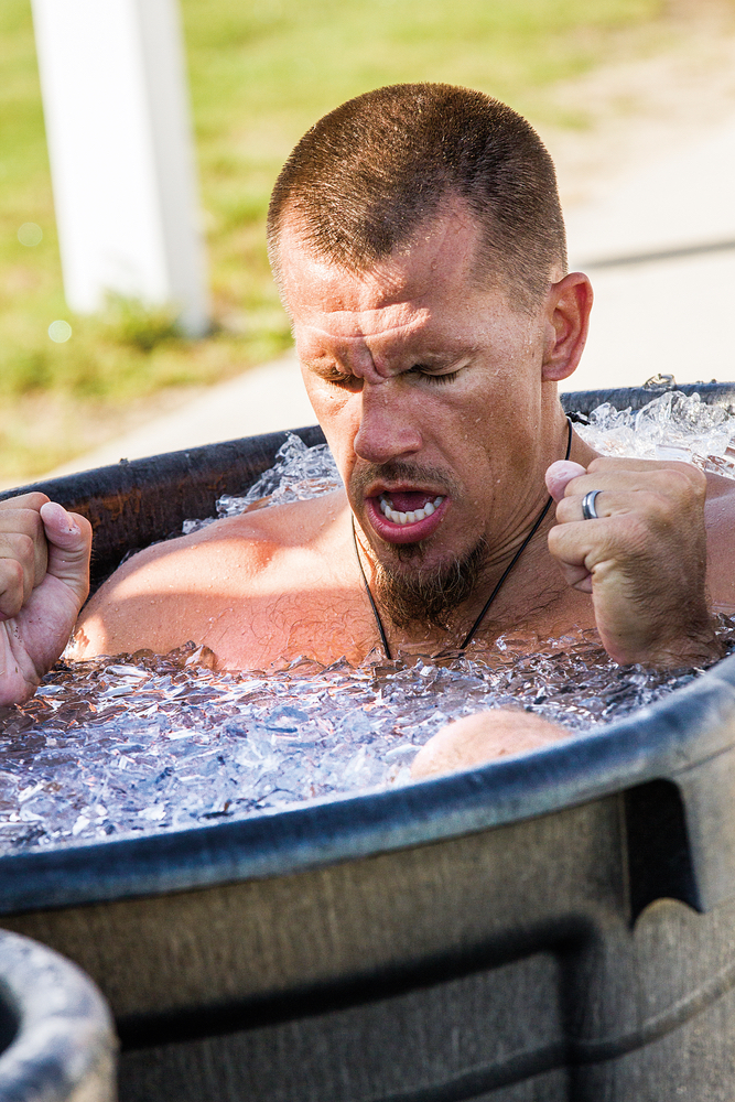 Man in an ice bath to prevent injury focus determination healthy living VitalityPro