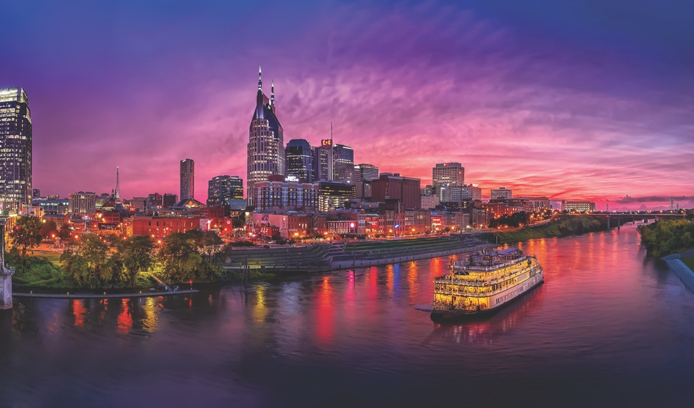 Nashville skyline at dusk city lights on the water VIE Magazine 2017