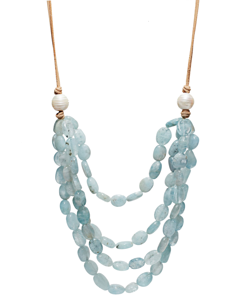 Twenty-inch necklace with four layers of hand-selected aquamarine stones on silk and natural leather with pearl clasp.