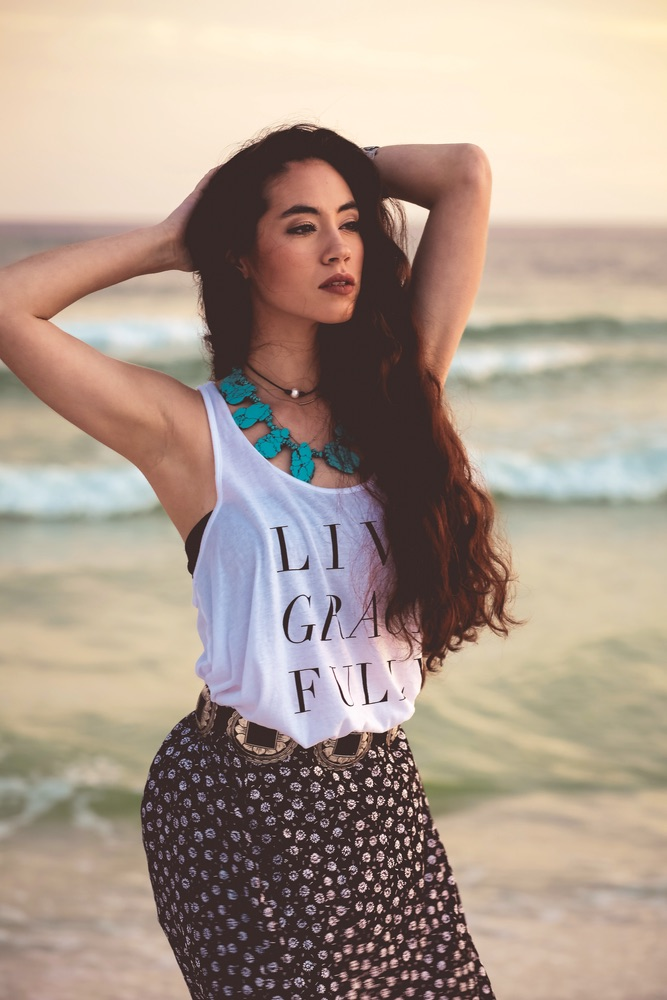 Beautiful model at the beach in a Graceful Rebel tank top Live Grace Fully
