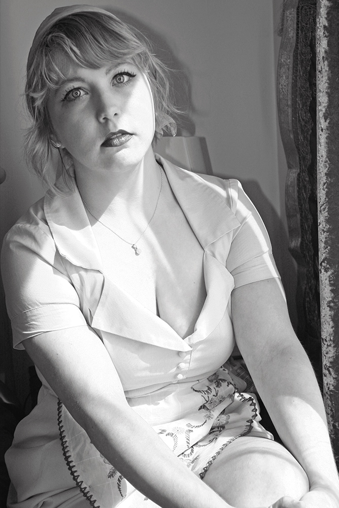 Writer Lizzie Locker in black and white photo by Sylvia Paret