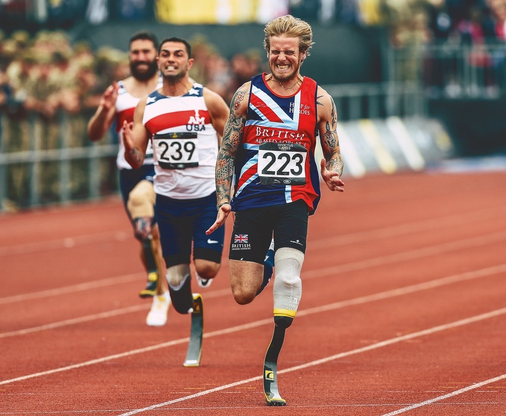 Runners compete in the men's IT1 100-meter dash at the Invictus Games