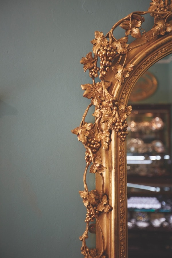 Ornate details on a mirror at John Farrington Antiques. VIE Magazine. The Sophisticate Issue