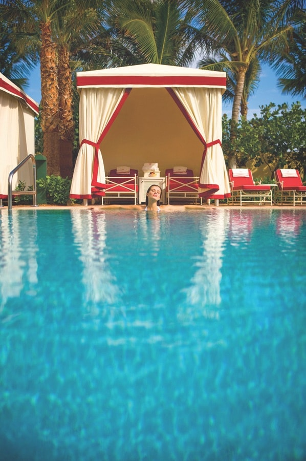 A woman relaxing poolside at Acqualine Resort & Spa.