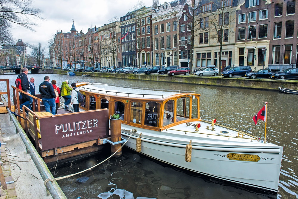 Jordaan Food and Canal Tour participants board the salon boat, The Tourist Amsterdam Food VIE Magazine Destination Travel 2018