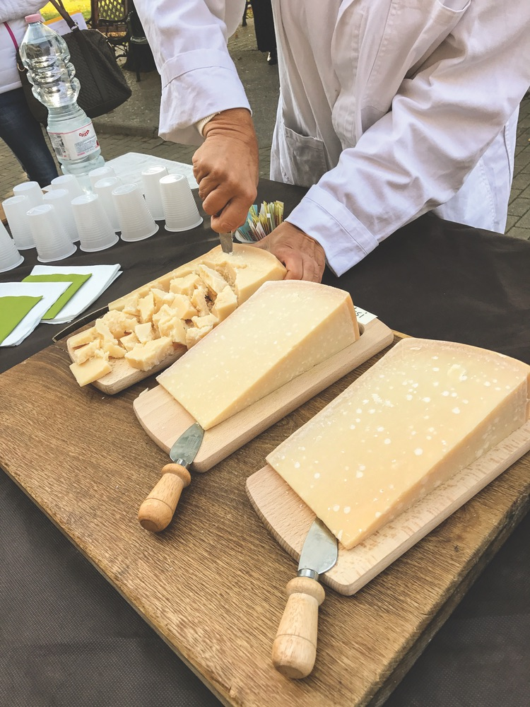 A cheesemaker demonstrates how to correctly break and serve Parmesan cheese. Photo by Carolyn O'Neil