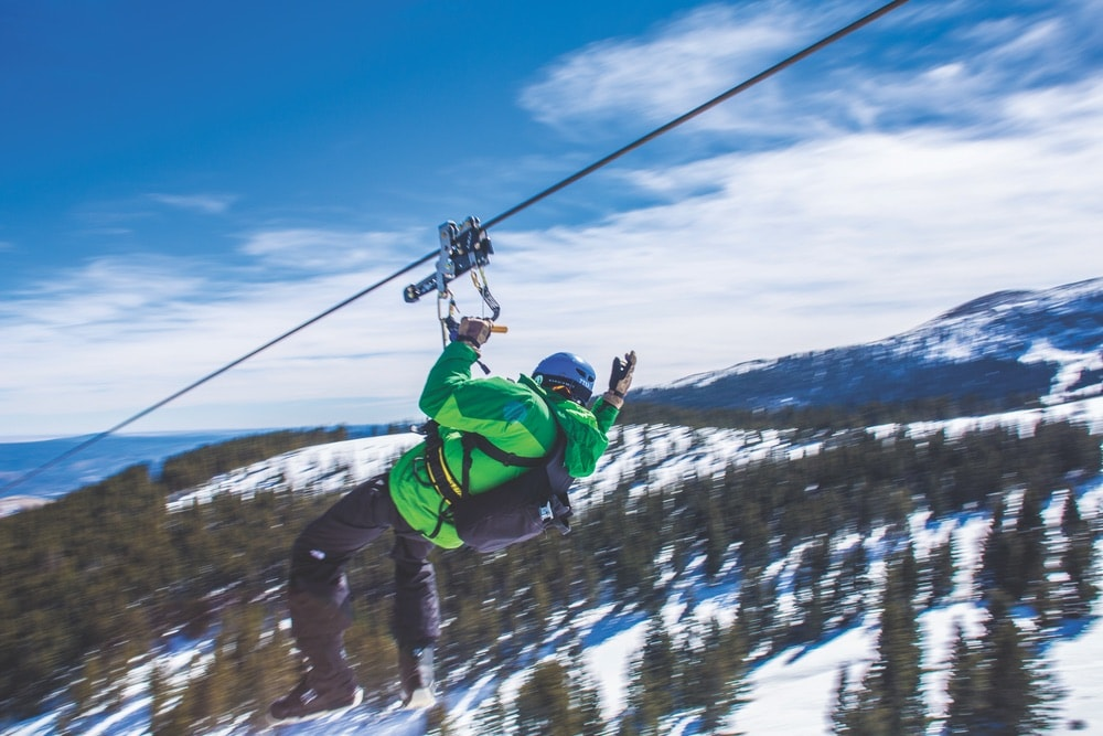 Zip-line through the New Mexico mountains. VIE Magazine FEB 18 Destination Travel