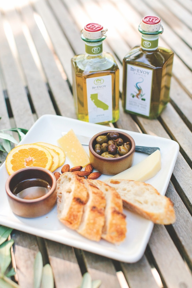 The McEvoy Ranch offers a seated tasting flight of three wines, seasonal bites, and their award-winning olive oil.