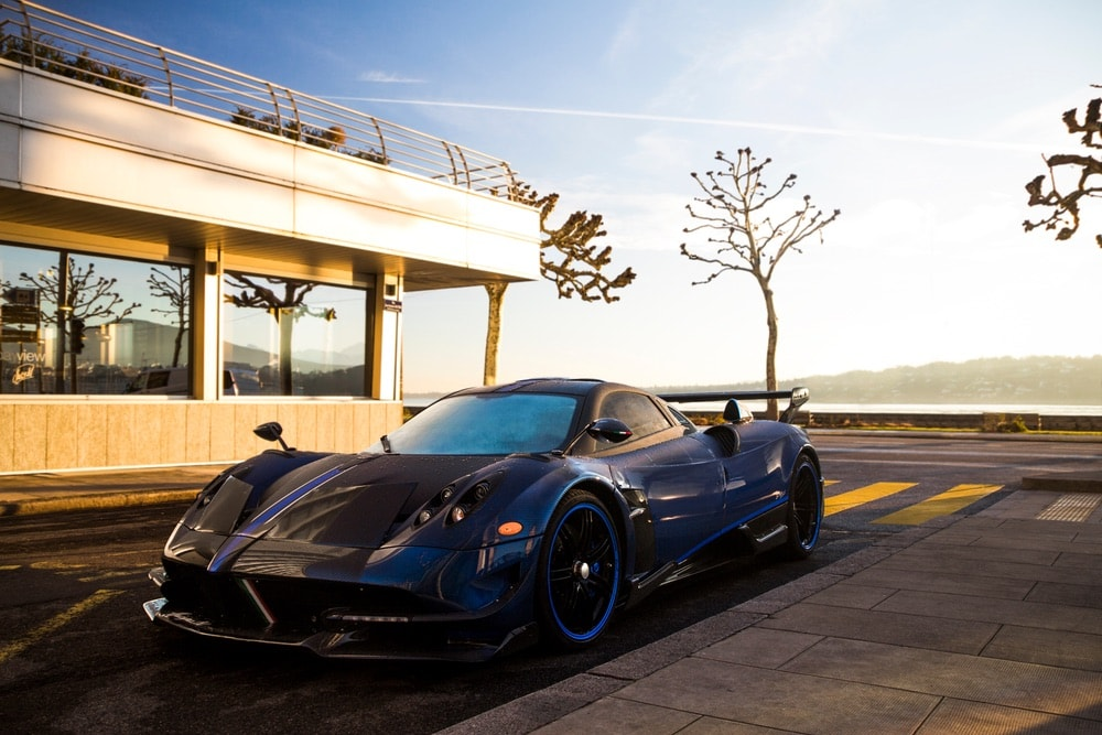 Pagani Huayra BC Macchina Volante hypercar parked at a luxury hotel in central Geneva.