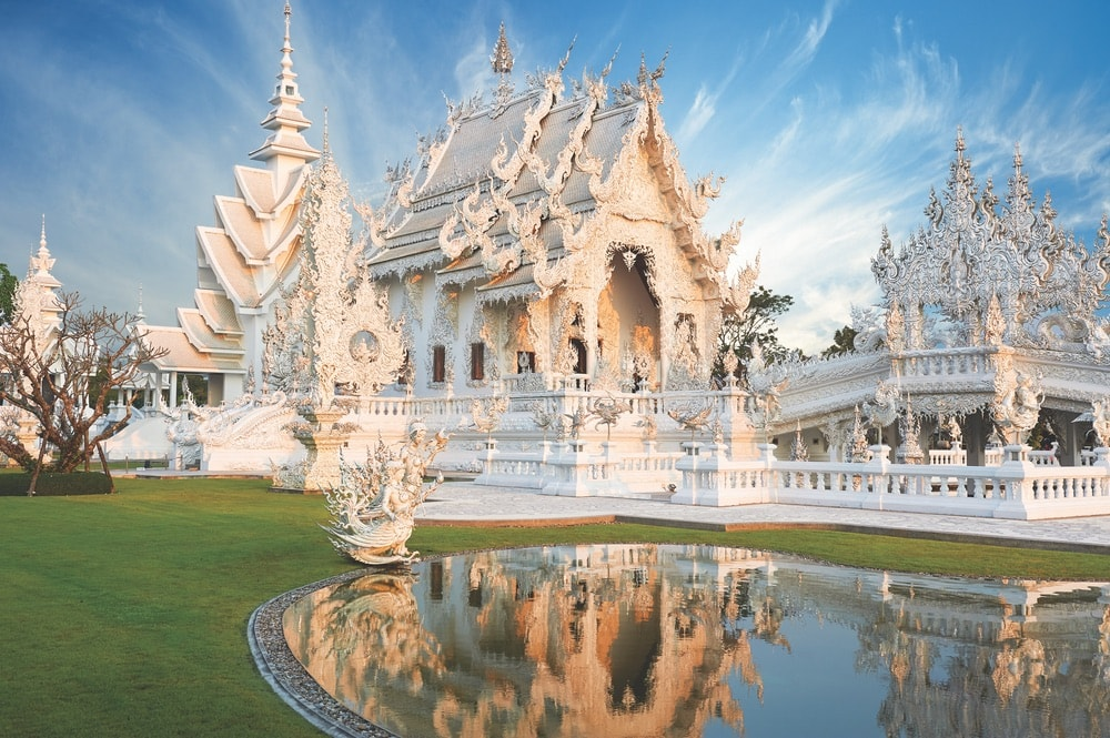 Beautiful ornate white temple located in Chiang Rai northern Thailand. Wat Rong Khun (White Temple), is a contemporary unconventional Buddhist temple.